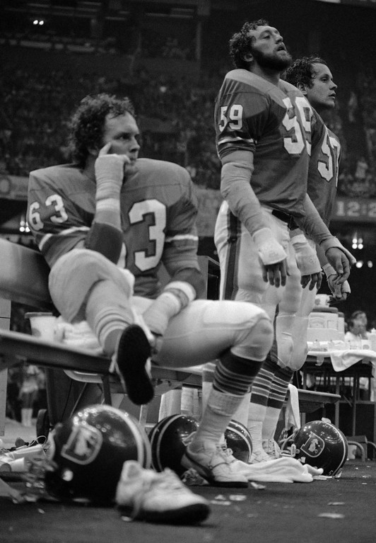 . Denver players John Grant (63), John Rizzo (59) and Randy Gradishar (53) watch Super Bowl XII from the sideline in New Orleans on Jan. 16, 1978. (AP Photo)