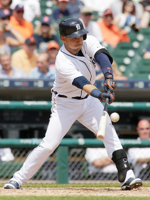 . Detroit Tigers\' Jose Iglesias singles to center field during the sixth inning of a baseball game against the Oakland Athletics at Comerica Park Thursday, June 4, 2015, in Detroit. (AP Photo/Duane Burleson)