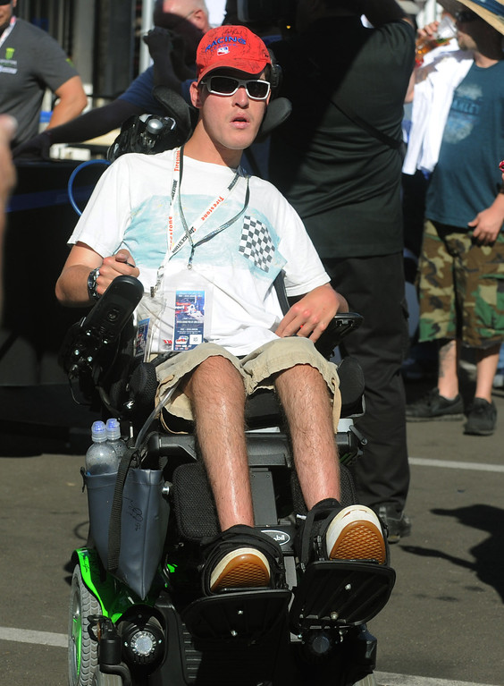 . 04-19-2013-(LANG Staff Photo by Sean Hiller)- Fans enjoy the warm weather at the Toyota Grand Prix Friday in Long Beach. Corey Capece,25, of Ontario is a huge race fan and his wheel chair is cluttered with autographs.