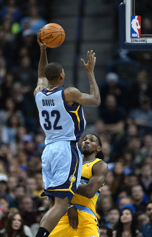 . DENVER, CO. - JANUARY 03:  Denver forward Kenneth Faried tried to draw a charge from Memphis forward Ed Davis (32) in the first half. The Denver Nuggets hosted the Memphis Grizzlies at the Pepsi Center Friday night, January 3, 2014. Photo By Karl Gehring/The Denver Post
