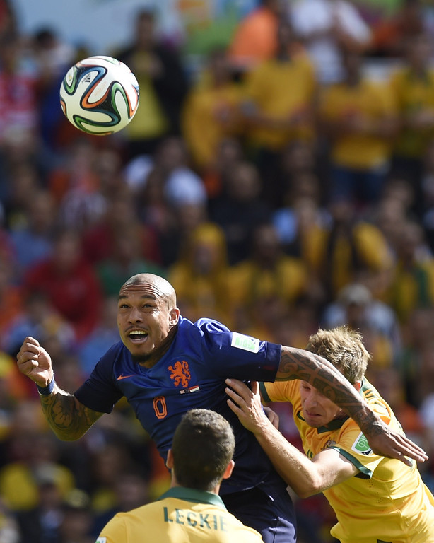 . Netherlands\' midfielder Nigel de Jong (L) heads the ball during a Group B football match between Australia and the Netherlands at the Beira-Rio Stadium in Porto Alegre during the 2014 FIFA World Cup on June 18, 2014.  JUAN BARRETO/AFP/Getty Images