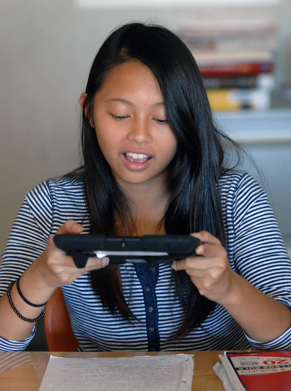 . Student Nikki Lao scans a paper with her iPad at Valley Academy of Arts & Sciences, Tuesday, October 15, 2013. The Valley Academy is one of two LAUSD schools in the San Fernando Valley that are participating in the rollout of the iPad plan. (Photo by Michael Owen Baker/L.A. Daily News)