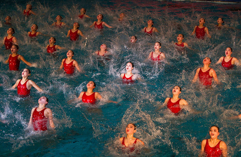 ". North Korean women perform in a mass synchronized swimming show to celebrate the birthday of the late leader Kim Jong Il in Pyongyang, North Korea on Wednesday, Feb. 15, 2012.  As a grand finale the women performed the song ""We Will Defend General Kim Jong Un at the Risk of Our Lives\"".  (AP Photo/David Guttenfelder)"