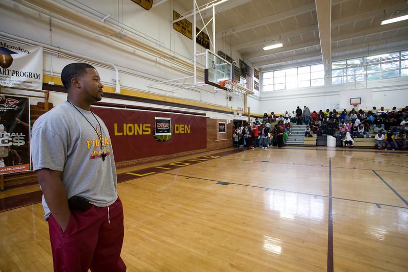 Aaron Brand (head football coach) awaits Jason Richardson's appearance at West Charlotte HS gym.