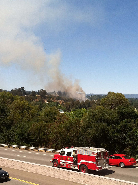 . A firetruck makes its way to a wildland fire in this photo taken from southbound Highway 1 near the Fishook about 3:10 p.m. Thursday. (Jeff Hutson/Contributed)