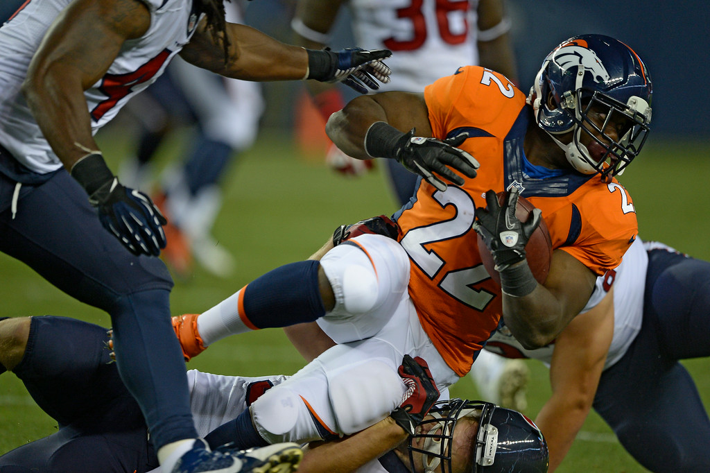 . DENVER, CO - AUGUST 23: Denver Broncos running back C.J. Anderson (22) picks up a couple yards against the Houston Texans August 23, 2014 at Sports Authority Field at Mile High Stadium. (Photo by John Leyba/The Denver Post)