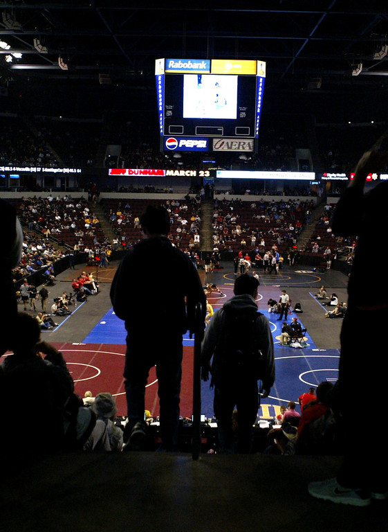 . Fans head to their seats on day two of the California Interscholastic Federation wrestling championships in Bakersfield, Calif., on Saturday, March 2, 2013. (Anda Chu/Staff)