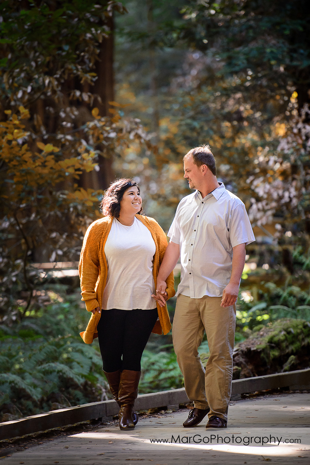 engaged couple walking at Muir Woods National Monument