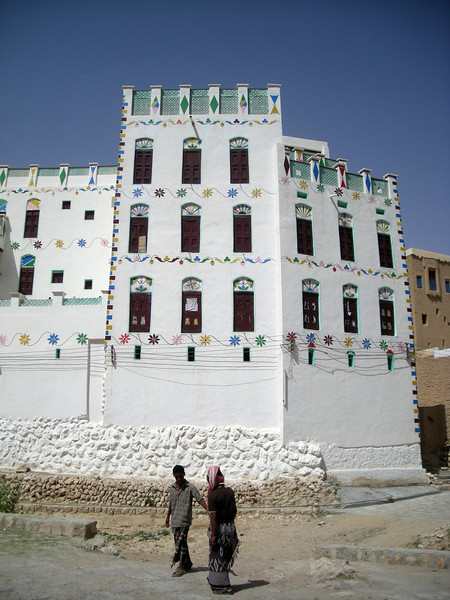 a painted mud brick home in a village in Wadi Daw'an