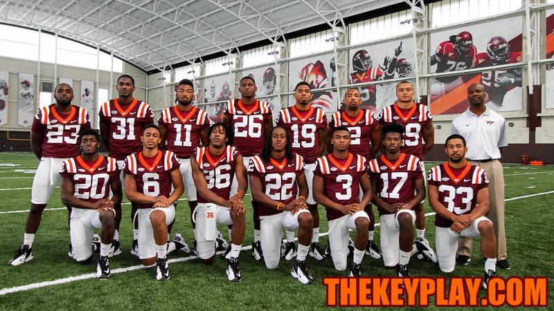 The defensive backs pose for a photo. (Mark Umansky/TheKeyPlay.com)