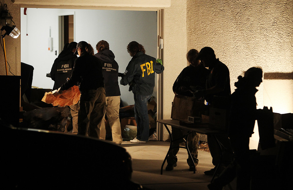 . FBI agents gather at the home of Christopher Jordan Dorner while conducting a search in Las Vegas on Feb. 7, 2013.  (Jason Bean/Las Vegas Review-Journal)