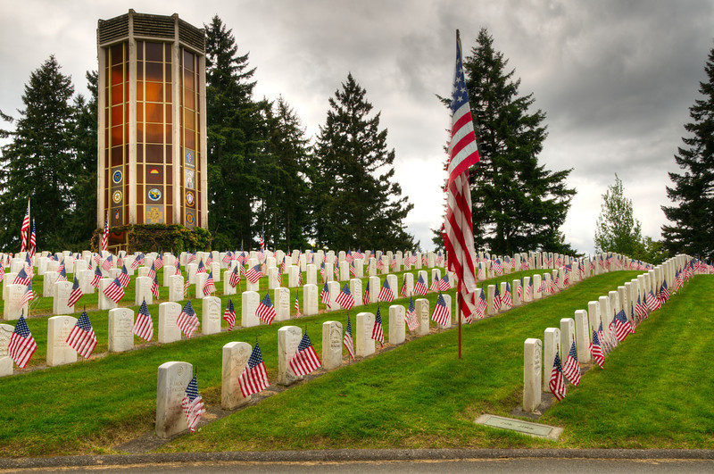 31 May 11.  We spent about an hour this morning at a local cemetery that has a large section honoring our service men and women. Each year they decorate the entire area with hundreds of American flags and a 1330 service. It is always a bit emotional to be present at such a time. Returning home I worked up a set of four images, which was three more than the total of American flags flying in our community, from which Jan selected this one. All of the images I worked up are HDR, so you will see some disruption in the flags as they were moving. I've elected to leave them as they are, as I felt it symbolized the disruption felt in the families of those who gave their all for the country and I couldn't think of a more fitting way to express it. Even though I think the image says it, I'll put it a words; a huge thank you to ALL who have served the country in uniform, be it for a single tour or a career. ISO 200; 1/500 sec (middle image of 5) @ f / 13.