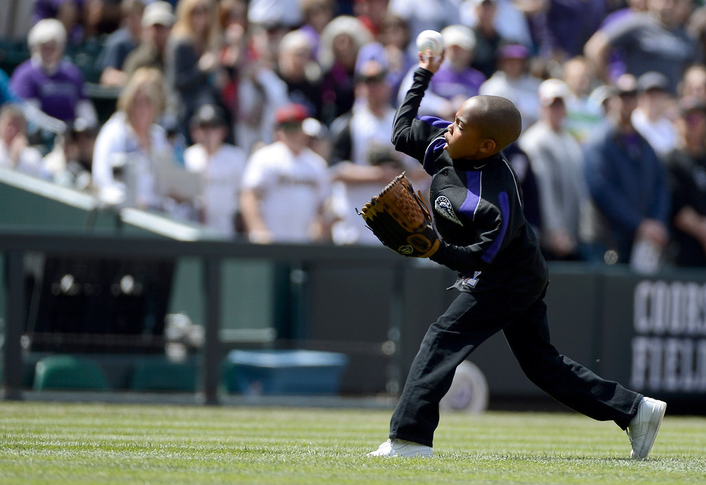 . DENVER, CO. - APRIL 21: Dallas Young 6-years-old, son of Colorado Rockies retired player Eric Young, throws out the first pitch to his older brother Eric Young Jr. prior to their game against the Arizona DiamondBacks April 21, 2013 at Coors Field. (Photo By John Leyba/The Denver Post)