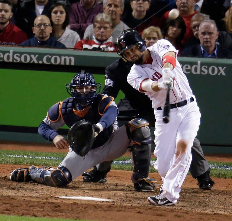 . Boston Red Sox\'s Shane Victorino hits a grand slam against the Detroit Tigers in the seventh inning during Game 6 of the American League baseball championship series on Saturday, Oct. 19, 2013, in Boston. (AP Photo/Charlie Riedel)