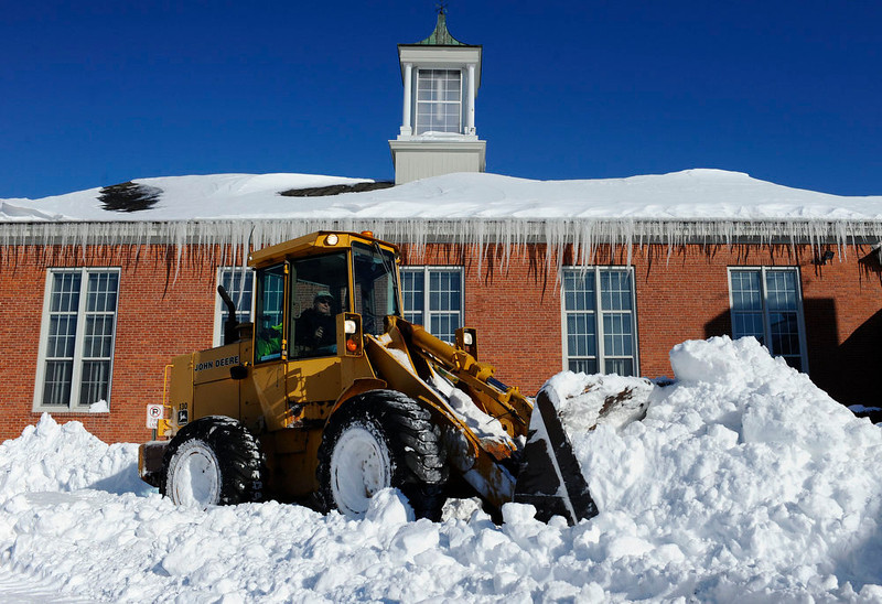 . A plow clears a path outside Poquonock Elementary School in Windsor, Conn., Sunday, Feb. 10, 2013.  A howling storm across the Northeast left much of the New York-to-Boston corridor covered with more than three feet of snow on Friday into Saturday morning. (AP Photo/Jessica Hill)