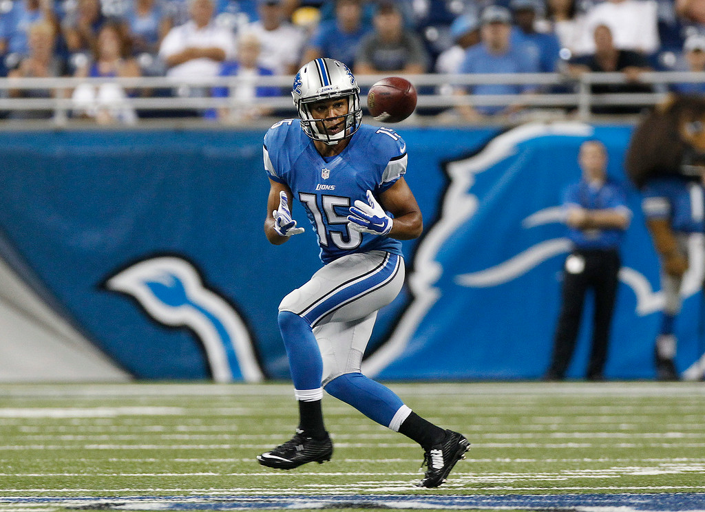 . Detroit Lions wide receiver Golden Tate catches a pass against the Jacksonville Jaguars in the first half of a preseason NFL football game at Ford Field in Detroit, Friday, Aug. 22, 2014.  (AP Photo/Duane Burleson)