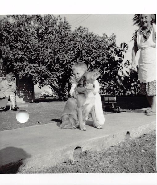David hugging Bear. Grandpa recovering from prostate, Grandma T. Sep 1955