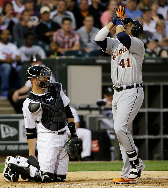 . Detroit Tigers\' Victor Martinez, right, celebrates after hitting a solo home as Chicago White Sox catcher Tyler Flowers looks on during the fifth inning of a baseball game in Chicago, Thursday, June 12, 2014. (AP Photo/Nam Y. Huh)
