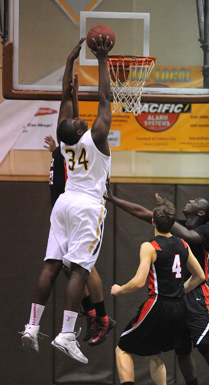 . TORRANCE - 02/15/2013 - (Staff Photo: Scott Varley/LANG) In a CIF Southern Section Division III-AAA second-round boys basketball matchup, West beat Hart 64-55. West\'s Terrell Carter dunks.