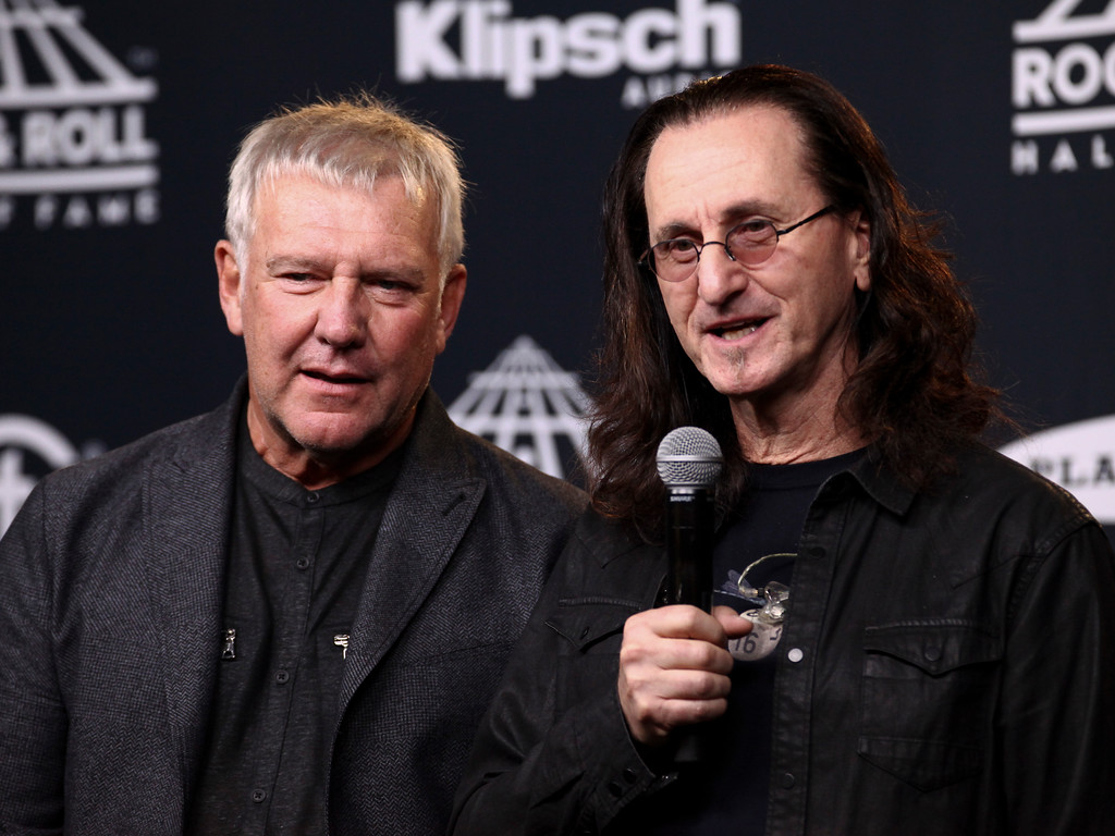 . Alex Lifeson, left, and Geddy Lee, right, of the band Rush appear in the 2017 Rock and Roll Hall of Fame induction ceremony press room at the Barclays Center on Friday, April 7, 2017, in New York. (Photo by Andy Kropa/Invision/AP)