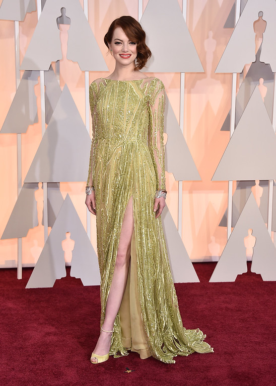 . Emma Stone arrives at the Oscars on Sunday, Feb. 22, 2015, at the Dolby Theatre in Los Angeles. (Photo by Jordan Strauss/Invision/AP)