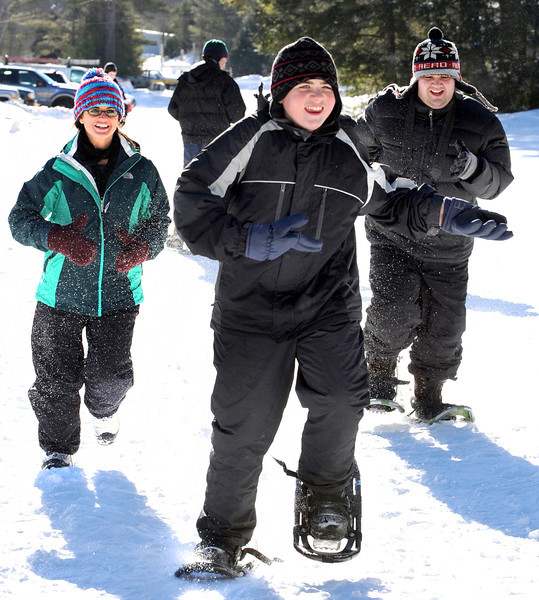 Brandon Wall, front, and Ben Dionne, right, compete in a practice race at Lost Valley Ski Area. At left, is their teacher, Bre Gallagher, from Margaret Murphy Center for Children. Special Olympics competition is so big now, that each year some groups have to take turns sitting out. Instead of going to Sugarloaf for this years Winter Special Olympics, some Special Olympians have their own competitions locally, with one coming up in February at Pettengill Park in Auburn.