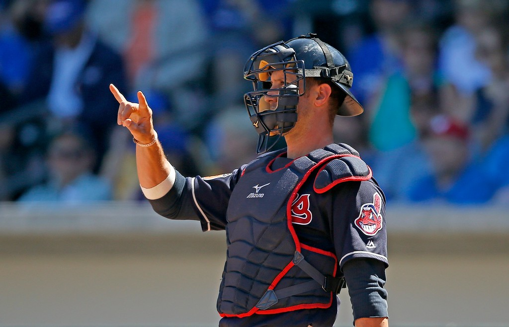 . Cleveland Indians catcher Yan Gomes signals to the infield during the first inning of a spring training baseball game against the Chicago Cubs Friday, March 24, 2017, in Mesa, Ariz. (AP Photo/Ross D. Franklin)
