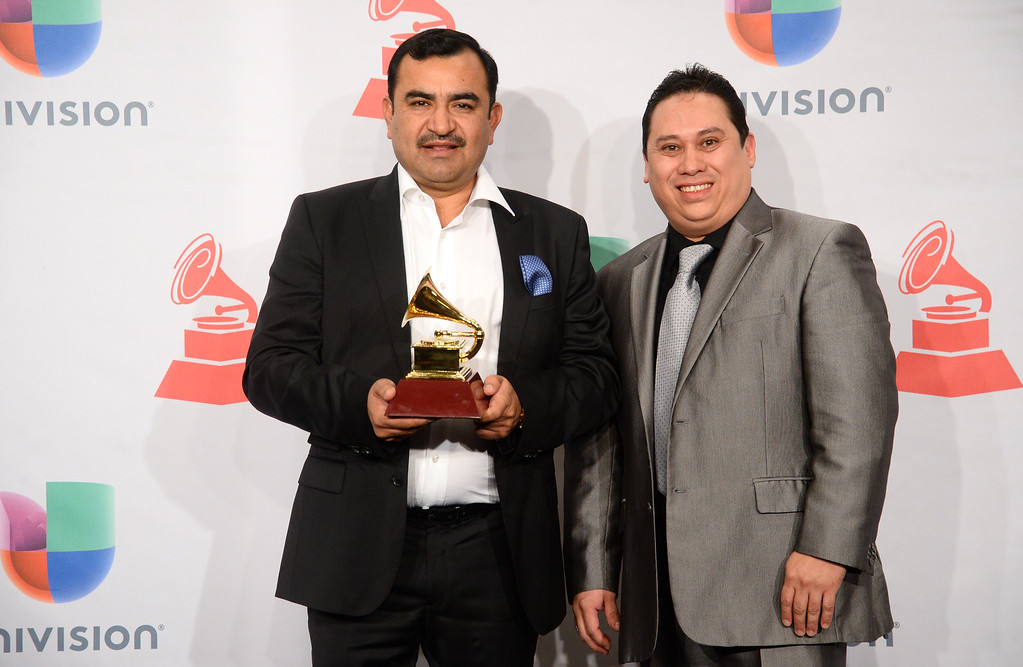 """. Juan Antonio Melendez, left, and Adrian Anthony Regalado pose in the press room with the best norteno album award for \""""Amor Amor\"""" at the 15th annual Latin Grammy Awards at the MGM Grand Garden Arena on Thursday, Nov. 20, 2014, in Las Vegas. (Photo by Al Powers/Invision/AP)"""