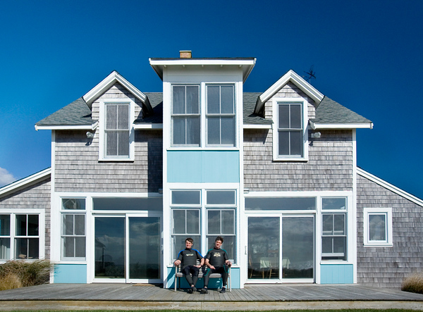 Boston Mag Hill Brothers sitting in front of house 2.jpg