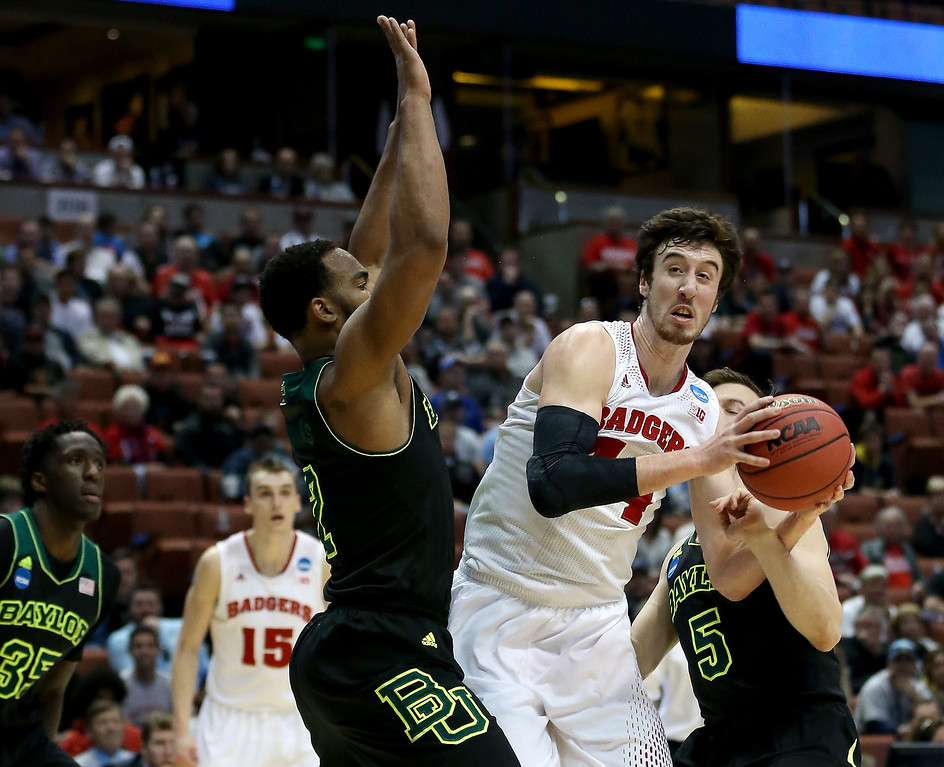 . Frank Kaminsky #44 of the Wisconsin Badgers looks to shoot against Rico Gathers #2 and Brady Heslip #5 of the Baylor Bears in the first half during the regional semifinal of the 2014 NCAA Men\'s Basketball Tournament at the Honda Center on March 27, 2014 in Anaheim, California.  (Photo by Jeff Gross/Getty Images)