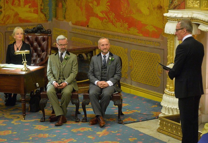 . Andrew Wale (2-L) and Neil Allard (2-R) look on as registrar Trevor Love (R) speaks during their wedding ceremony at the Royal Pavillion in Brighton early on March 29, 2014.  The ceremony is one of several same-sex marriages taking place in Britain as a change in the law came into effect at midnight.  (LEON NEAL/AFP/Getty Images)