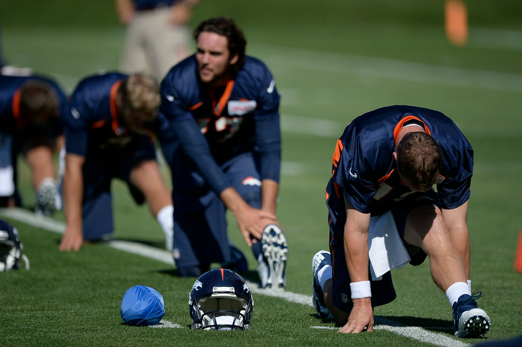 . Denver Broncos quarterback Peyton Manning (18) stretches during the start of the Denver Broncos 2014 training camp July 24, 2014 at Dove Valley. (Photo by John Leyba/The Denver Post)