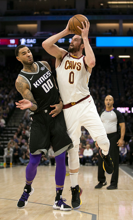 . Cleveland Cavaliers forward Kevin Love, right, is fouled by Sacramento Kings center Willie Cauley-Stein during the first quarter of an NBA basketball game, Wednesday, Dec. 27, 2017, in Sacramento, Calif. (AP Photo/Rich Pedroncelli)
