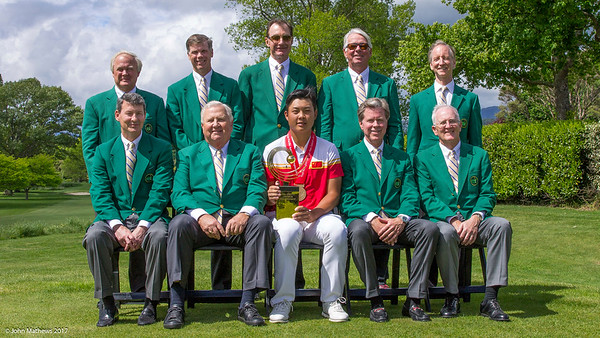 Members of the Masters together with Yuxin Lin from China and his trophy after winning the Asia-Pacific Amateur Championship tournament 2017 held at Royal Wellington Golf Club, in Heretaunga, Upper Hutt, New Zealand from 26 - 29 October 2017. Copyright John Mathews 2017.   www.megasportmedia.co.nz