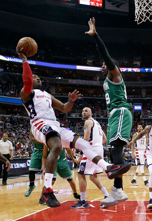 . Washington Wizards guard John Wall (2) shoots past Boston Celtics forward Jae Crowder (99) during the second half of game 6 of the Eastern Conference semifinal NBA basketball playoff series, Friday, May 12, 2017, in Washington. The Wizards won 92-91. (AP Photo/Alex Brandon)