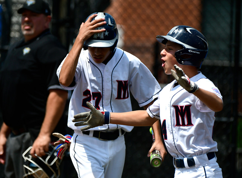 8/8/2018 Mike Orazzi | Staff Mid Island New York Little League's Steven Martinez (27) and Gregory Bruno (24) at Breen Field in Bristol.