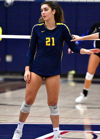 11/1/2018 Mike Orazzi | Staff RHAM High School's Bella Johnson (21) during the CCC Volleyball Tournament at Avon High School Thursday night.