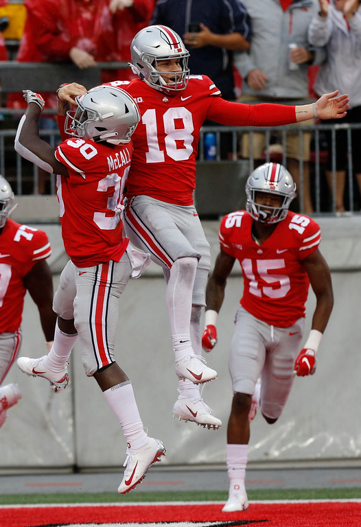. Ohio State quarterback Tate Martell (18) celebrates his touchdown against Rutgers during the second half of an NCAA college football game Saturday, Sept. 8, 2018, in Columbus, Ohio. Ohio State beat Rutgers 52-3. (AP Photo/Jay LaPrete)