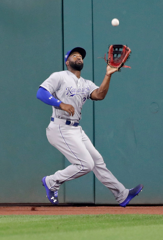 . Kansas City Royals\' Brian Goodwin catches Cleveland Indians\' Edwin Encarnacion\'s sacrifice fly in the second inning of a baseball game, Tuesday, Sept. 4, 2018, in Cleveland. (AP Photo/Tony Dejak)