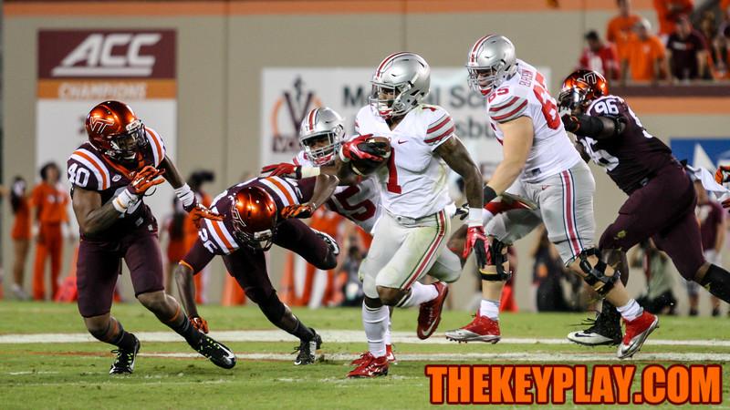 Braxton Miller (1) avoids a flock of Hokies defenders on a long time. (Mark Umansky/TheKeyPlay.com)