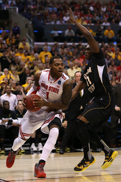 . LOS ANGELES, CA - MARCH 30:  Deshaun Thomas #1 of the Ohio State Buckeyes drives on Cleanthony Early #11 of the Wichita State Shockers in the first half during the West Regional Final of the 2013 NCAA Men\'s Basketball Tournament at Staples Center on March 30, 2013 in Los Angeles, California.  (Photo by Jeff Gross/Getty Images)
