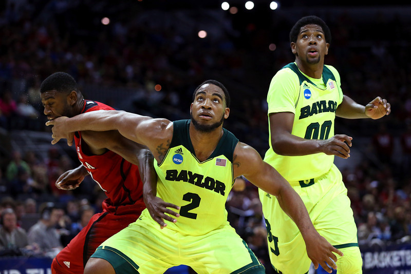 . Rico Gathers #2 of the Baylor Bears boxes out against Leslee Smith #21 of the Nebraska Cornhuskers as Royce O\'Neale #00 looks on in the first half during the second round of the 2014 NCAA Men\'s Basketball Tournament at AT&T Center on March 21, 2014 in San Antonio, Texas.  (Photo by Ronald Martinez/Getty Images)