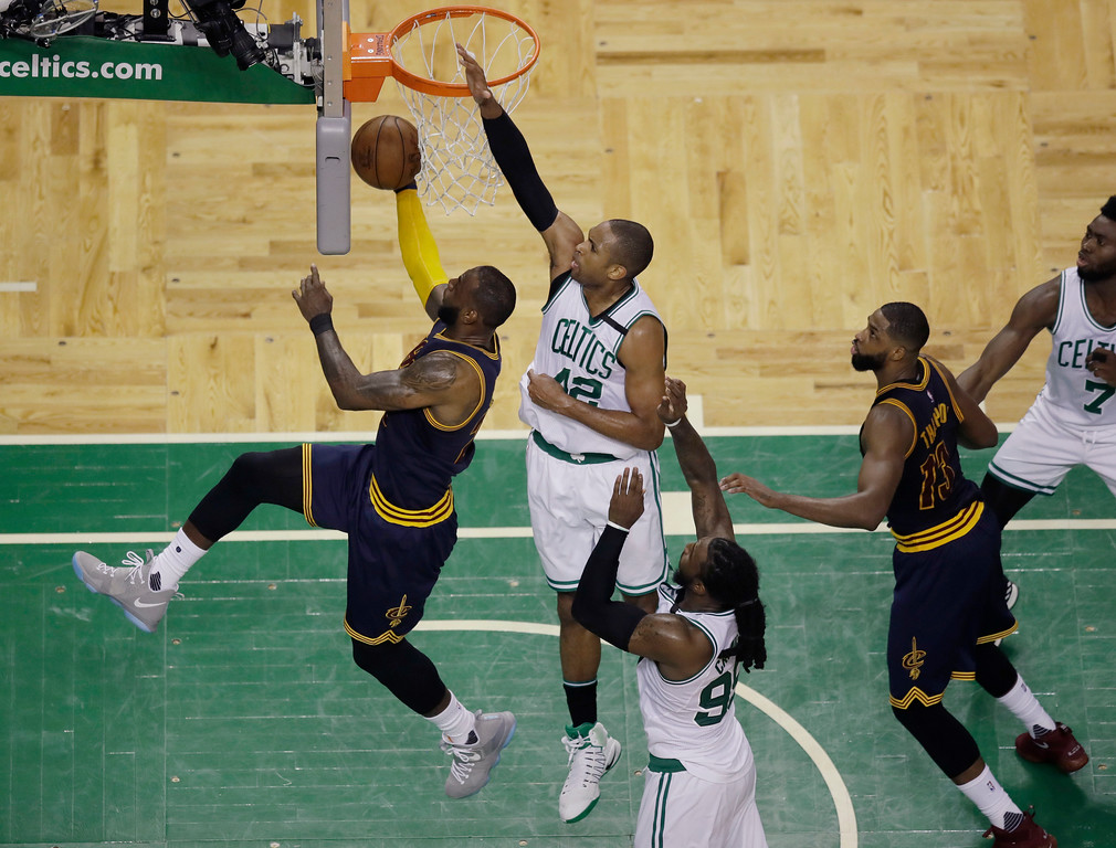 . Cleveland Cavaliers forward LeBron James, left, drives for a layup in front of Boston Celtics center Al Horford (42) during the second quarter of Game 1 of the NBA basketball Eastern Conference finals, Wednesday, May 17, 2017, in Boston. (AP Photo/Charles Krupa)
