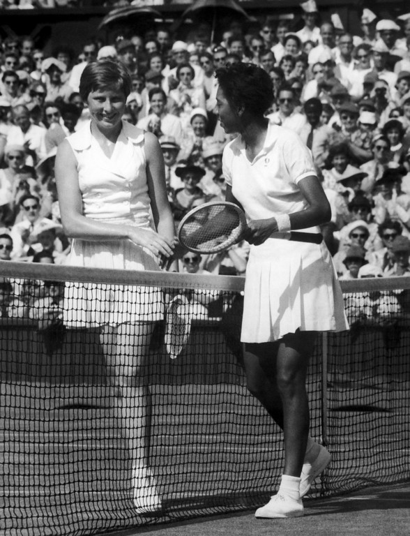 . Althea Gibson of New York, right, and Christine Truman of Woodford, Essex, England, left, shake hands over the net after their ladies? singles semi-final of the All-England Lawn Tennis championships at Wimbledon, London, England on July 4, 1957. Miss Gibson won 6-1, 6-1. (AP Photo/John Rider-Rider)