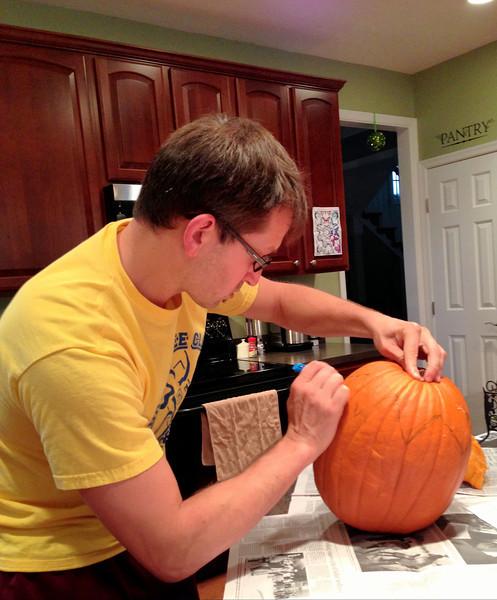 Workin' on his pumpkin