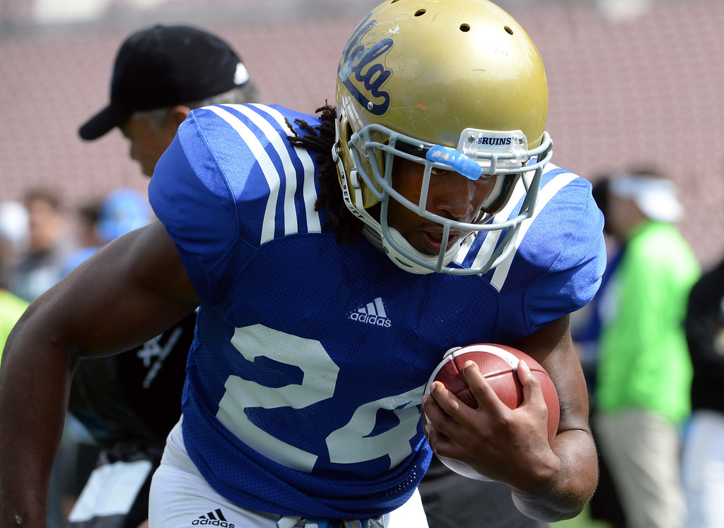 . UCLA Bruins running back Paul Perkins (24) during a NCAA college spring football game at the Rose Bowl in Pasadena, Calif., Saturday, April 25, 2015.