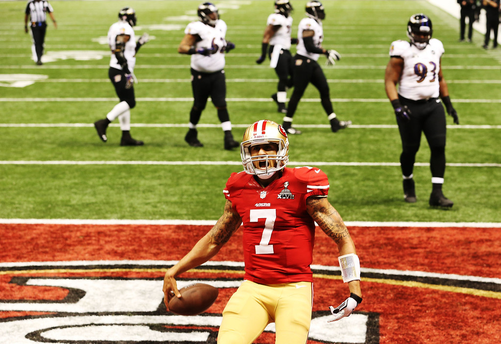 . Colin Kaepernick #7 of the San Francisco 49ers celebrates after he scored a 15-yard rushing touchdown in the fourth quarter against the Baltimore Ravens during Super Bowl XLVII at the Mercedes-Benz Superdome on February 3, 2013 in New Orleans, Louisiana.  (Photo by Ronald Martinez/Getty Images)