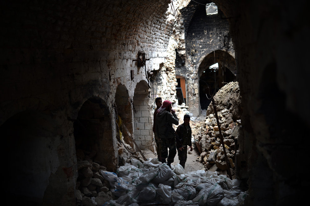 . A picture taken on April 16, 2013 shows Syrian rebel fighters standing amid sandbags in a damaged section of the Umayyad Mosque complex which has served as a key battleground since last July, with rebels seeking the ouster of Bashar al-Assad\'s regime laying siege twice but each time only managing to retain control for less than 48 hours. Aleppo\'s ancient Umayyad mosque, which slid back into rebel control for a third time after prolonged clashes, offers a chilling window into the intractability of the Syrian civil war, now in its third year.   DIMITAR DILKOFF/AFP/Getty Images