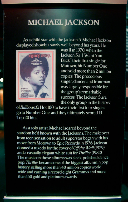 . A plaque rests near an exhibit of Michael Jackson\'s artifacts at the Rock and Roll Hall of Fame and Museum Thursday, June 25, 2009, in Cleveland.  (AP Photo/Tony Dejak)