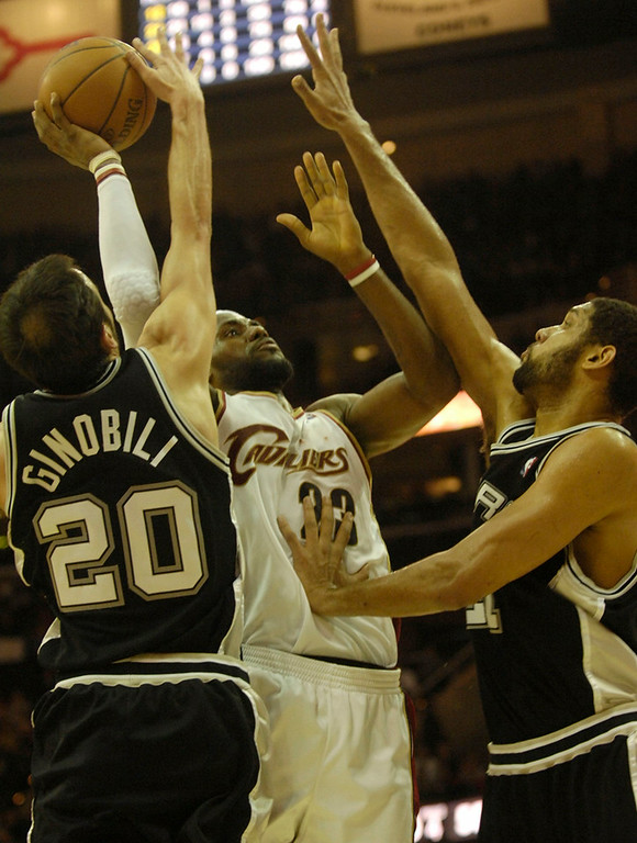 . Michael Blair/MBlair@News-Herald.com The Cavs\' LeBron James is fouled by the Spur\'s Manu Ginobili as Tim Duncan helps out with time running out in the fourth quarter of Wednesday\'s game at The Q.